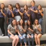 Members wearing Delta Phi Lambda Sorority, Inc. clothing