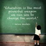 "Child at chalkboard (text) ""Education is the most powerful weapon we can use to change the world."" - Nelson Mandela"