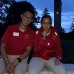 Photo of vince and another cyclone aide by the campanile at dusk